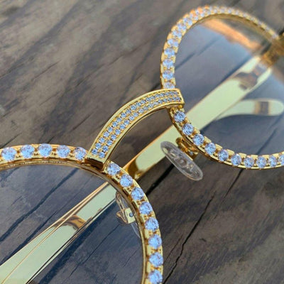 LFY ICED Baller Glasses in Gold, front of the glasses shown from an angle, best out
