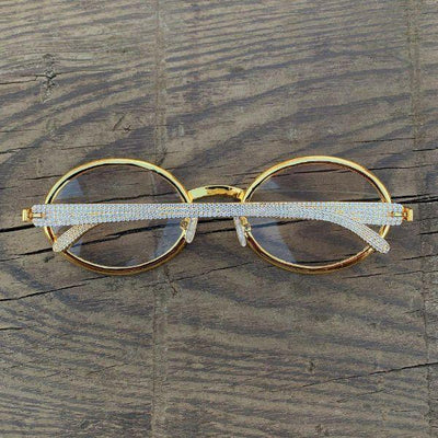 LFY ICED Baller Glasses in Gold shown against a wood background, showing the front of the glasses, best out