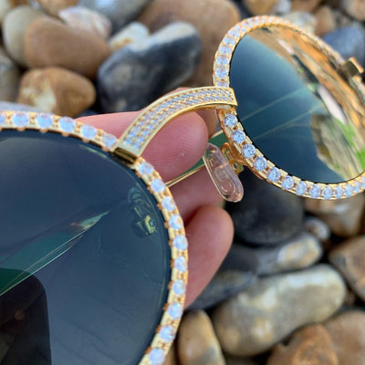 LFY ICED Baller Sunglasses in Gold (Green Tint), close up of the front of the glasses being shown, best out