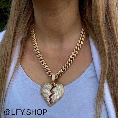 ICED Broken Heart Pendant in Gold (RED CENTRE) shown being worn around a woman's neck, best out