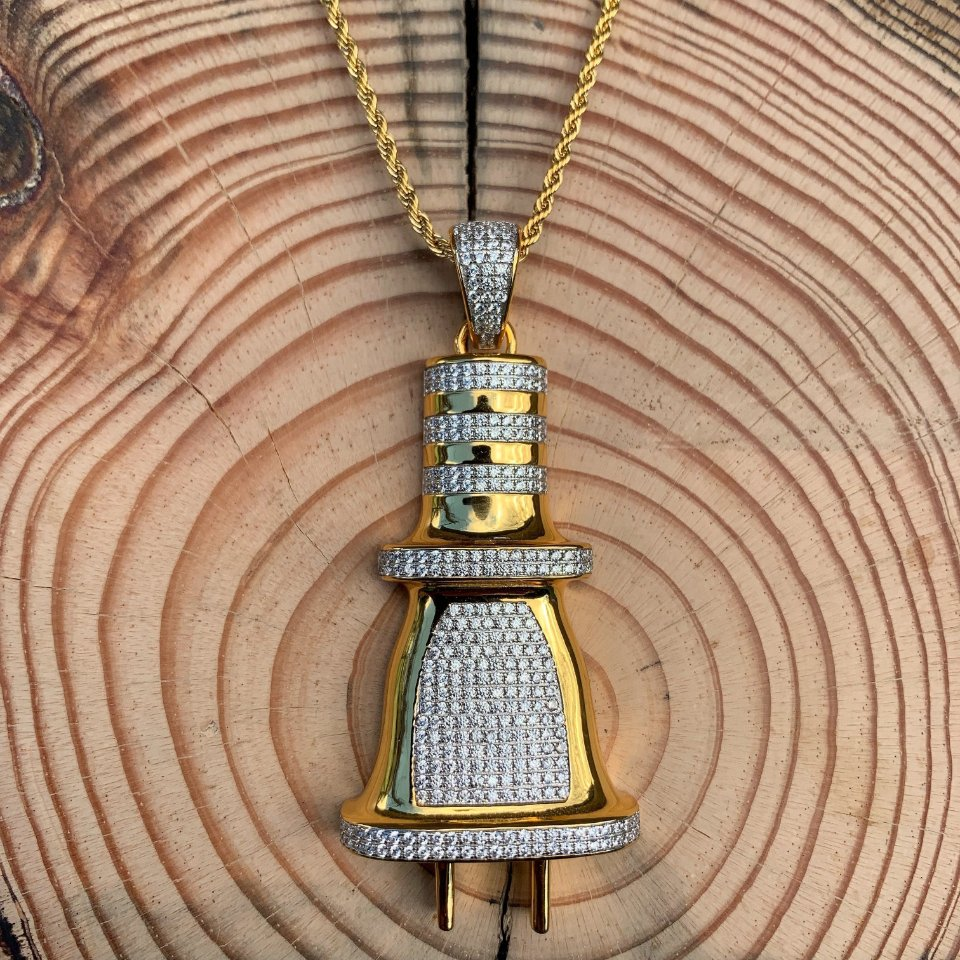 ICED OG Plug Pendant in Gold shown against a wood background, best out.
