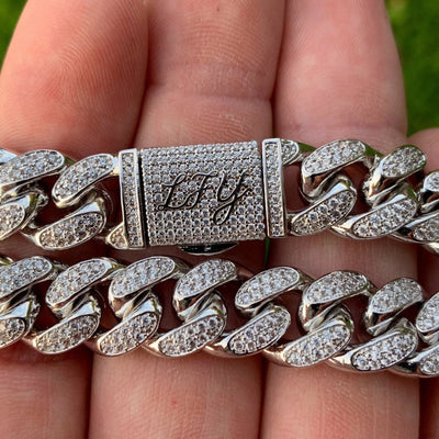 (NEW DESIGN) 12mm ICED Cuban Bracelet in White Gold, clasp and front of the jewellery being shown.