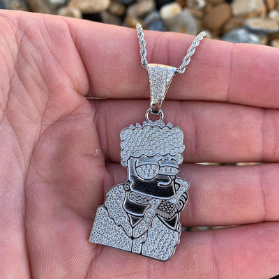 ICED Bart Simpson in White Gold, pendant shown in the palm of a man's hands, best out.