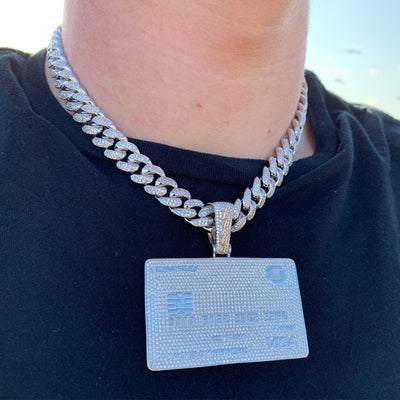 ICED Bank Card Pendant in White Gold shown being worn on a chunky chain around a man's neck, best out.