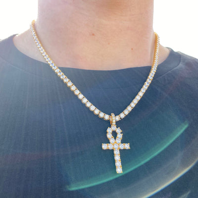 ICED Ankh Cross Pendant in Gold shown being worn around the neck of a man in a black tshirt, best out
