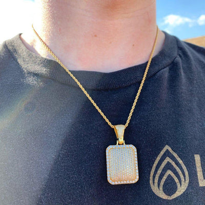 ICED Dog Tag Pendant in Gold shown being worn around a man's neck, best out