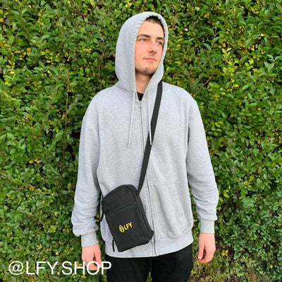 LFY Baller Man Bag (Yellow Logo) shown being worn by a man in a grey hoodie