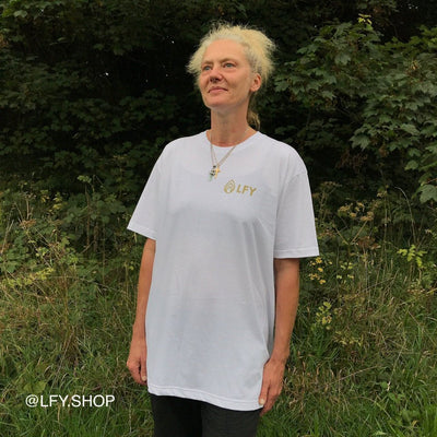 LFY Baller T-Shirt (White) shown being worn by a woman in a field
