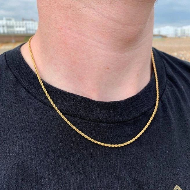 2mm Rope Chain in Gold shown being worn around a man's neck, on the beach.