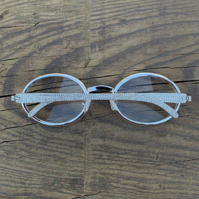 LFY ICED Baller Glasses in White Gold, back of the glasses being shown against a wood background, best out