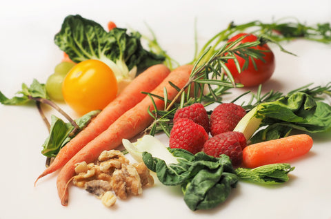 Colorful carrots, kale, strawberries, cherries, broccoli, walnut, almonds