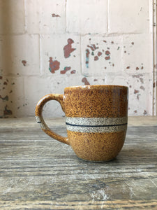 Speckled stoneware mug with handle