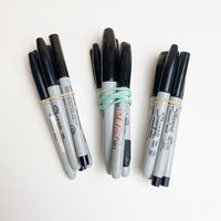 Five Black Permanent Markers
