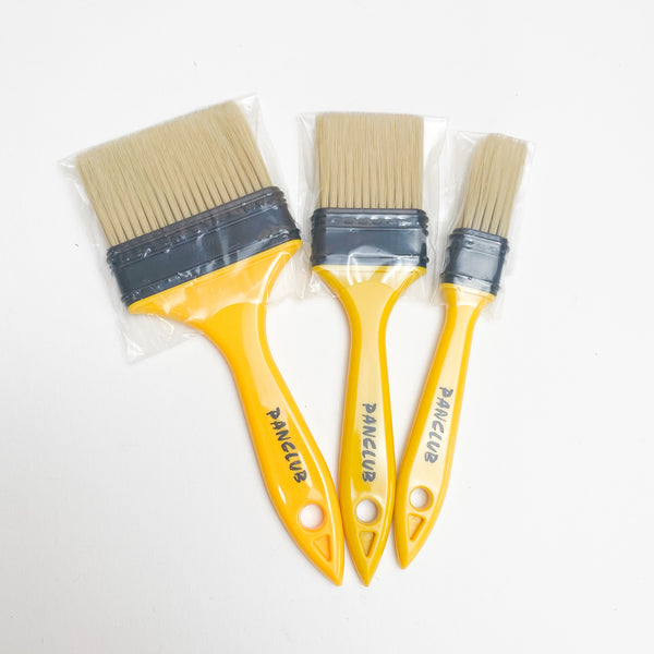 Set of Three Yellow Paint Brushes