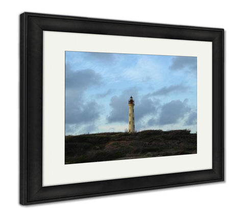 Framed Print, Wind Blown Scrub In Front Of The California Lighthouse In Aruba