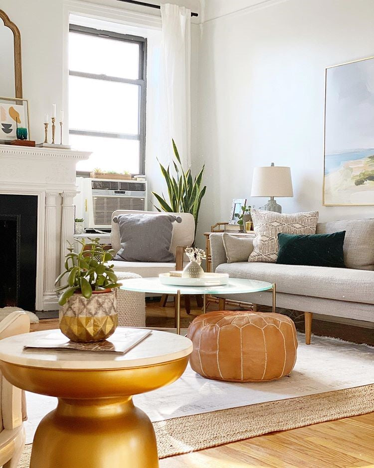 tan brown moroccan pouf in living room