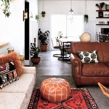 Load image into Gallery viewer, brown moroccan pouf in living room by maison morocco