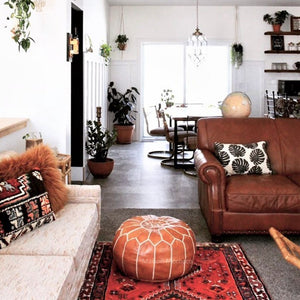 brown moroccan pouf in living room by maison morocco
