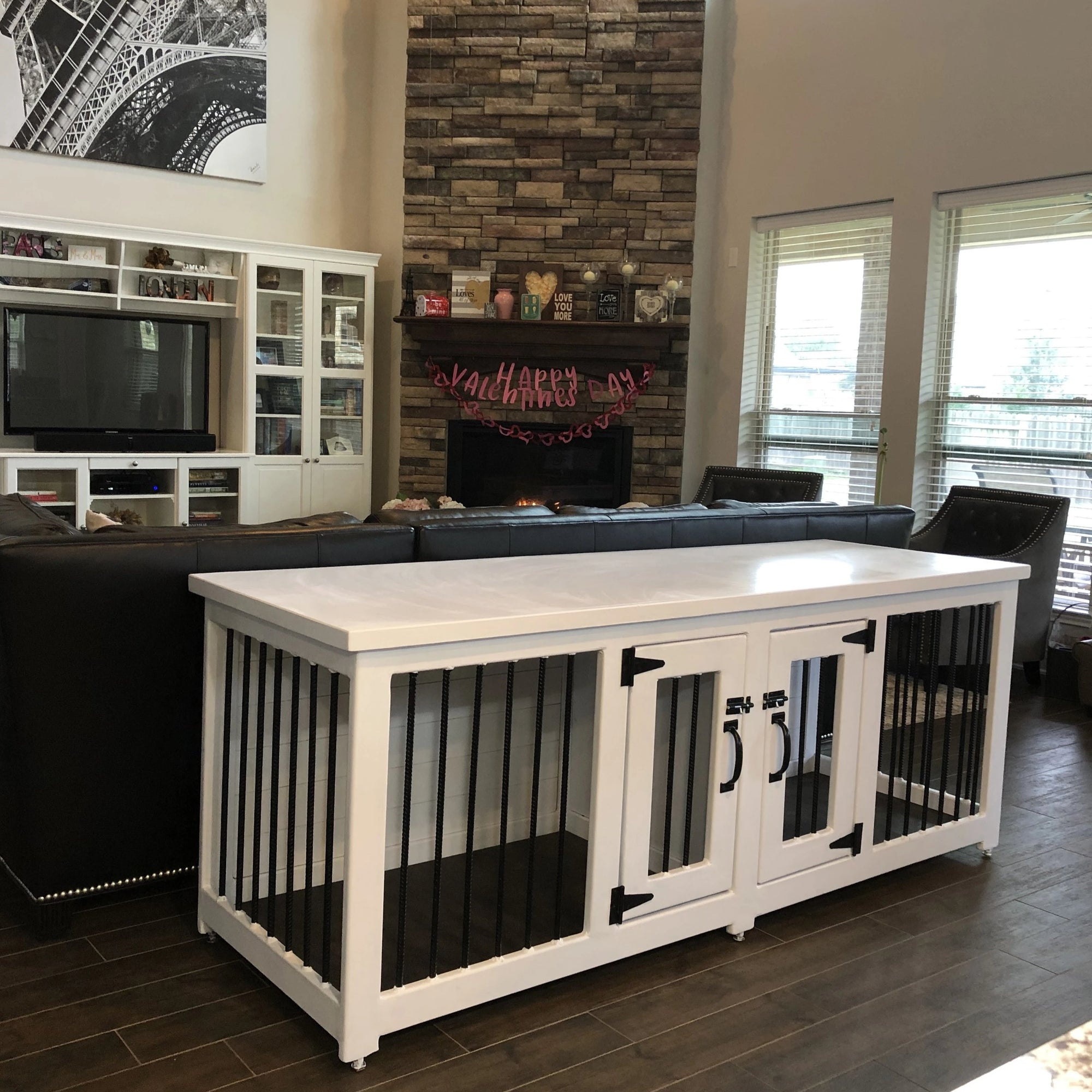 White and Black Metal Dog Kennel in a living room in Houston Texas