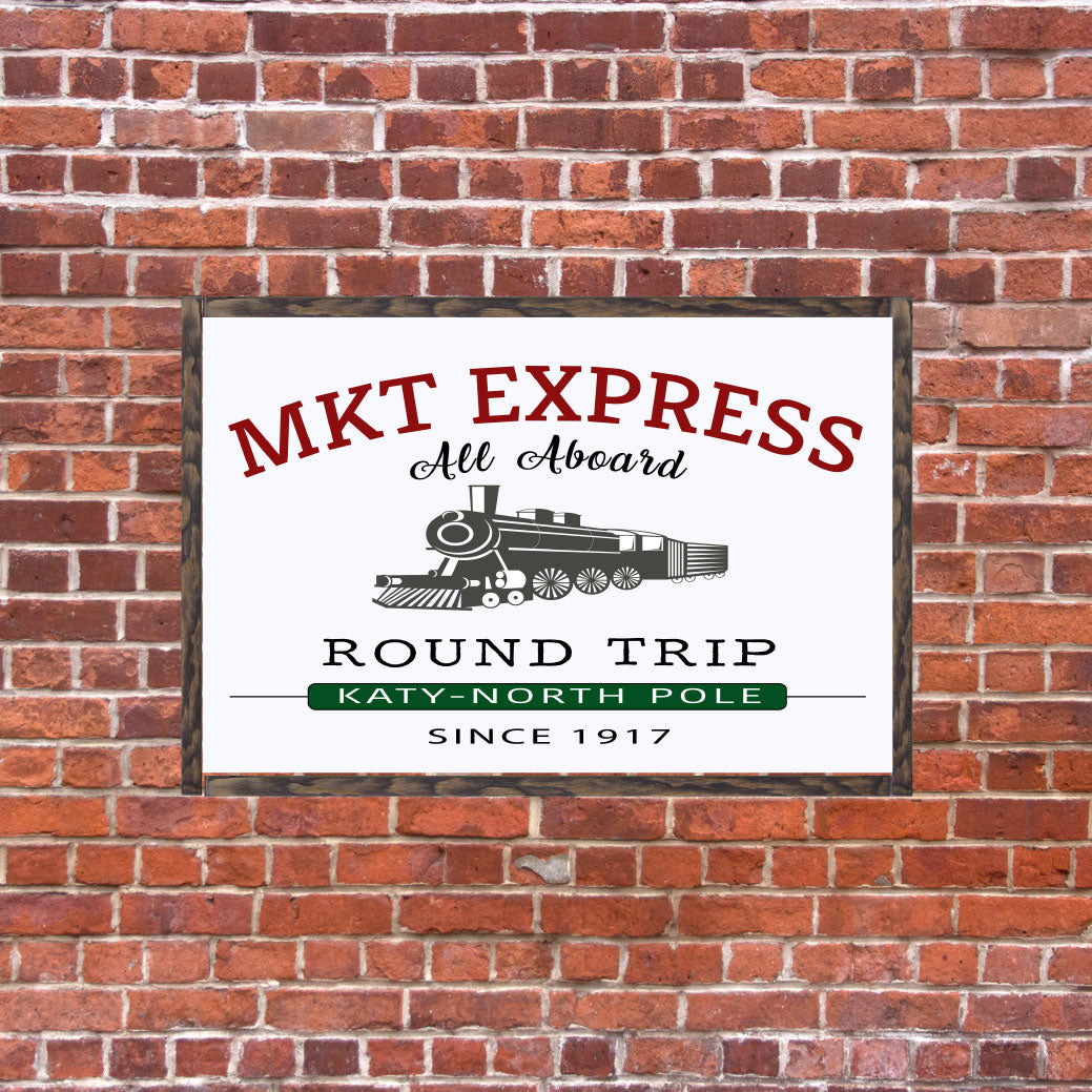 Holiday Sign with saying MKT Express round trip Katy North Pole Since 1917