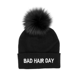 "Black Knitted ""Bad Hair Day"" Beanie with Fox Pom Pom"