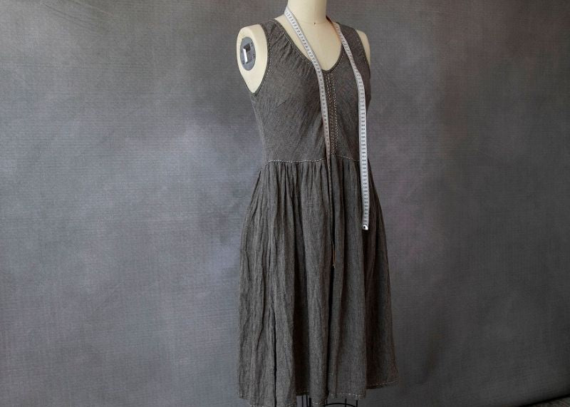 Eva Cassis dress made from sustainable fabric hanging on a mannequin