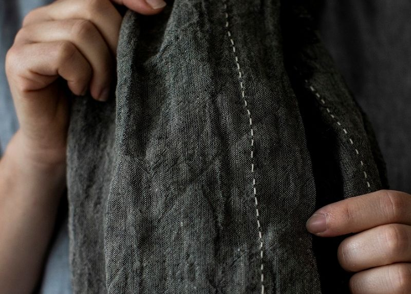 Woman's hands holding European Flax Scarf