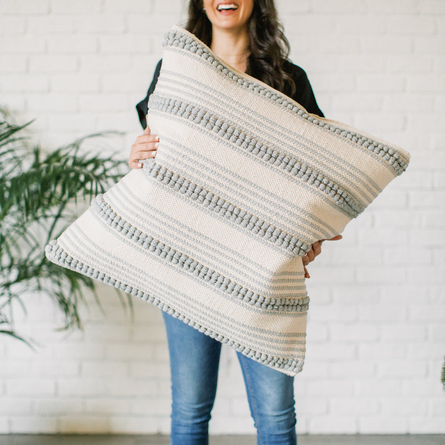Show_Cushions_Grey_Ripple_Justine_Holding