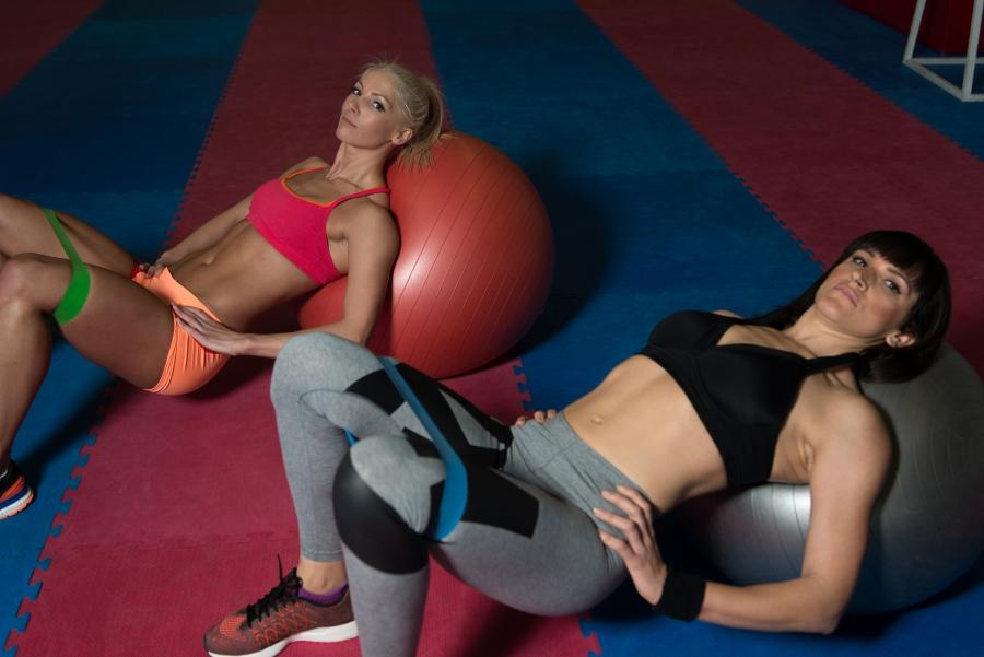 two women training with resistance bands.