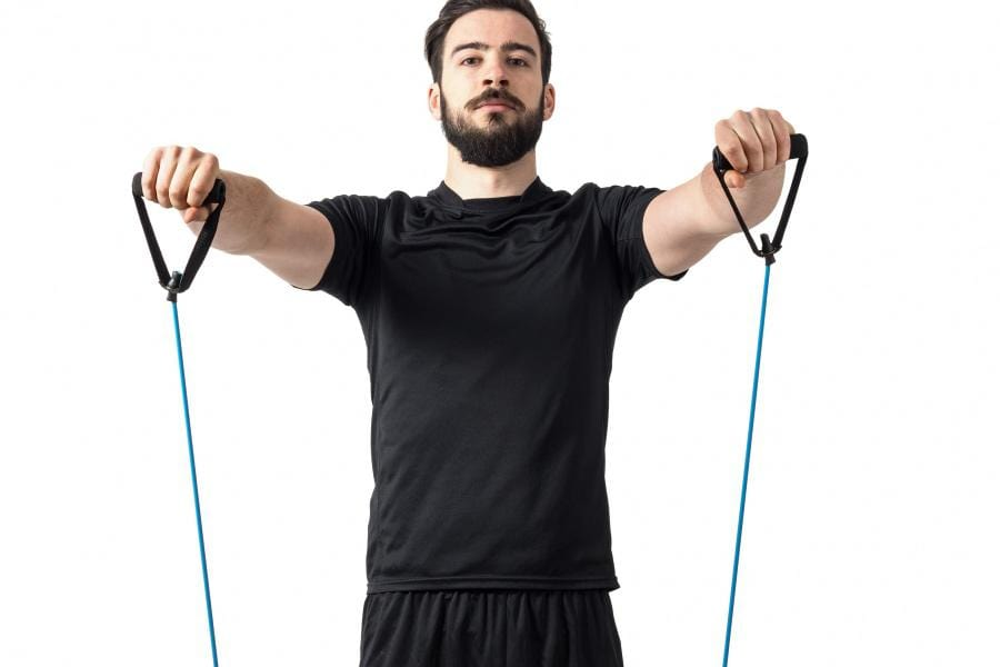 Man doing front raises with a resistance band.
