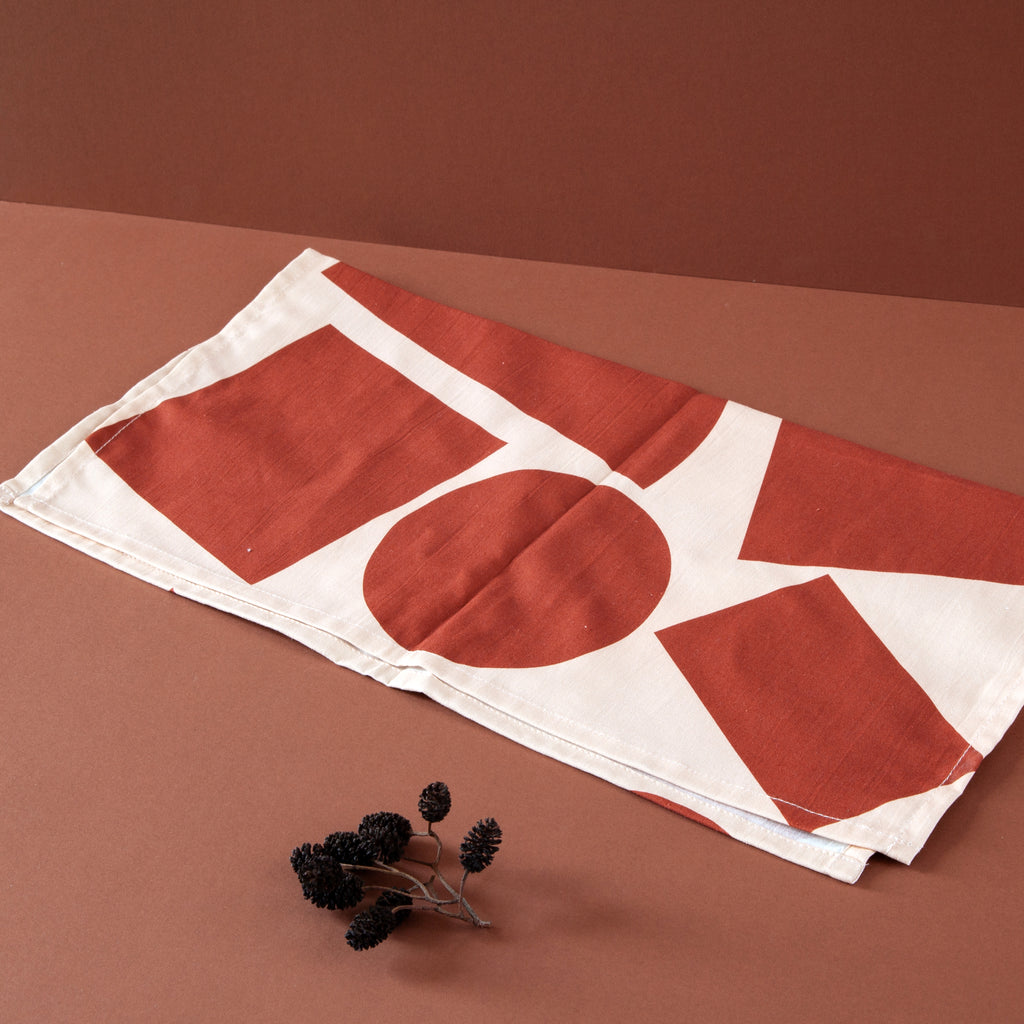 Ola Organic Cotton Wrap with Shapes Print in Salmon and Red. Made in Japanese Furoshiki style, washable and reusable.