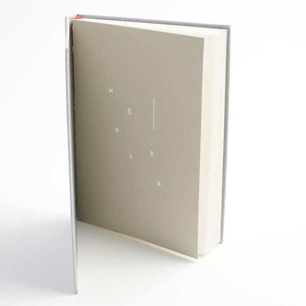 Moglea Harbor Cloth Notebook with lay flat ruled or blank pages. Hardcover with back pocket insert.