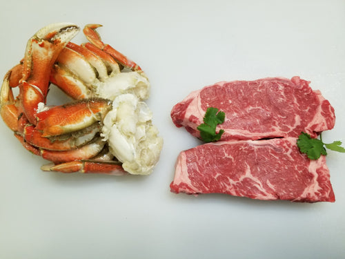 Two Choice New York Steaks One Pound of Dungeness Crab Clusters