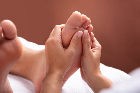 Person getting a specialty foot massage to relieve their plantar fasciitis pain