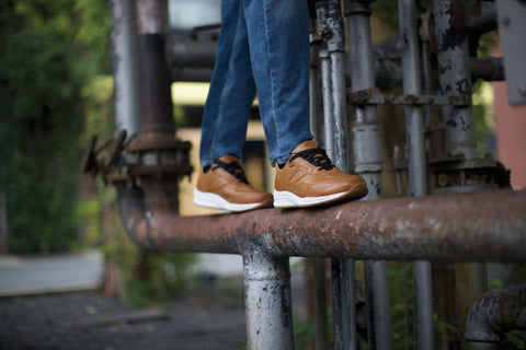 Man walking on a rusted pipe wearing comfortable walking shoes from SAS