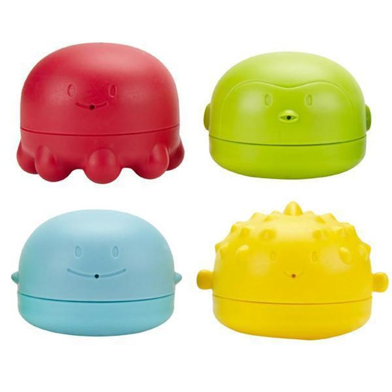 Ubbi bath squeeze & switch toys multi