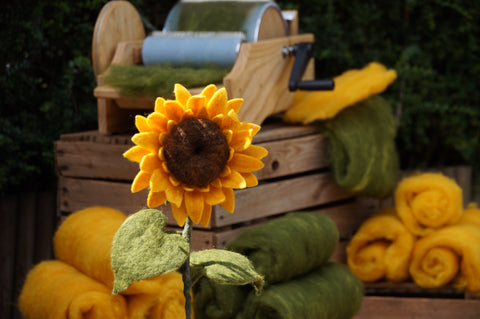 Needle Felted Sunflower with wool batts in the background