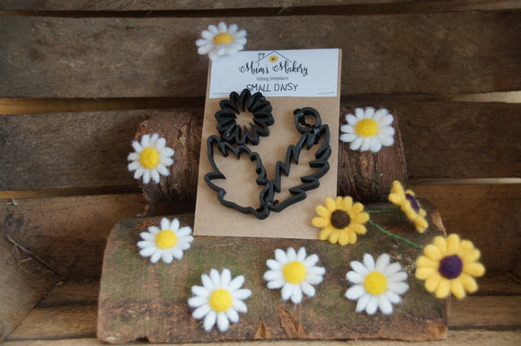 Daisy Needle Felting Template surrounded by felted daisies