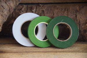 florist tape in 3 colours on a log background