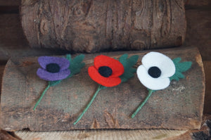 Purple, Red and White needle felted poppies on a rustic wooden log for armistice day