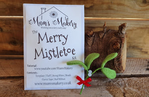 Needle Felted Mistletoe sprig with little red bow, log and rustic wooden background