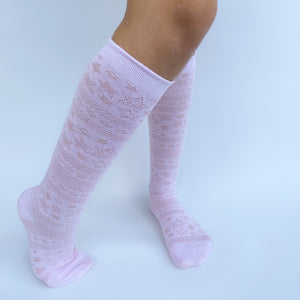 Knee high socks with pattern.  White