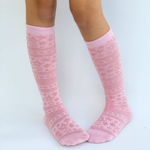 Knee high socks with pattern. Baby pink