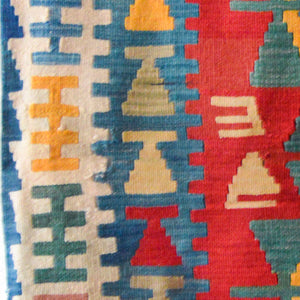 Comb symbol on authentic Turkish woolen kilim