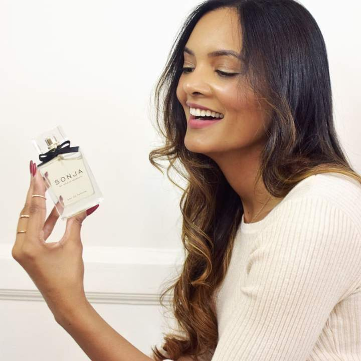 a woman holding a cell phone