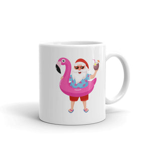 Santa Claus on Christmas Vacation With a Pink Flamingo graphic Mug