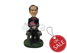 Custom Bobblehead Sophisticated Smart Man Sitting In Formal Dress With Legs Folded And Hands Wrapped Around A Bouquet - Leisure & Casual Casual Males Personalized Bobblehead & Cake Topper