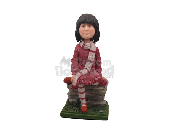 Custom Bobblehead Cute Girl In Winter Dress Sitting On A Rock With One Leg Folded And Scarf Around Her Neck - Leisure & Casual Casual Females Personalized Bobblehead & Cake Topper