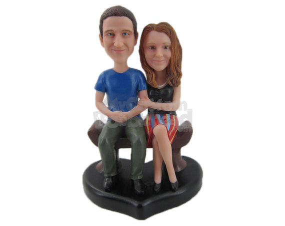Custom Bobblehead Couple Sitting On Bench Wearing Casual Outfit Ready For A Picture - Wedding & Couples Bride & Groom Personalized Bobblehead & Cake Topper