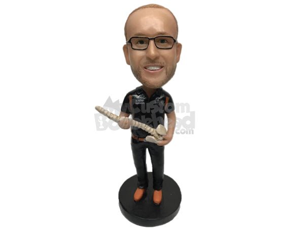 Custom Bobblehead Chiropractor In Medical Attire Holding A Spine In Hand - Careers & Professionals Chiropractors Personalized Bobblehead & Cake Topper